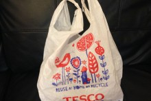Large stores and supermarkets locally and across England have begun charging customers 5p for every plastic carrier bag given out.