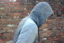 A ban on hoodies covering faces has been introduced in parts of Sefton in an attempt to tackle crime and anti-social behaviour.