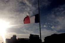 The French flag was raised to half-mast at the Town Hall and a minute's silence was held for the victims of the Paris terrorism attacks.