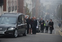 Around 2,000 mourners, including up to a thousand UK policemen and women, paid tribute to PC Dave Phillips at his cathedral funeral.