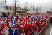 The city centre was a festive sea of red with a splash of blue as around 7,000 turned up to take part in the 2015 Liverpool Santa Dash.