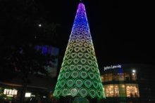 Scousers were urged to 'Get Christmassy' as the Liverpool One Christmas tree was illuminated to kick-off the festive period.