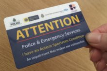 A special needs charity has collaborated with Merseyside Police to create the autism attention card.