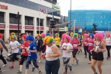 Asea ofretro Liverpool 80s-style perms were on show as thousandstook part inthe Echo Scouse 5k fun run.