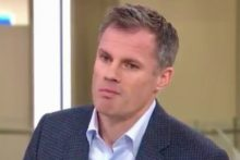 Ex-Liverpool star Jamie Carragher has been suspended by Sky after a video emerged of him spitting at a taunting fan