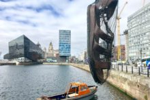A humungous sandal hangs suspended over Canning Dock and more curious sights are appearing ahead of the Giants' arrival.