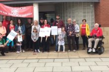 Wirral residents marched to highlight the distance many will have to travel if local walk-in services are removed.