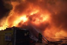 Emergency services battled overnight to contain a large fire at a Birkenhead recycling centre.