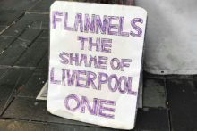 Campaigners stood outside the doors of Flannels in Liverpool One to protest over the sale of fur products.