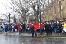 International Women's Day brought over 100 protesters together outside the Bombed Out Church.